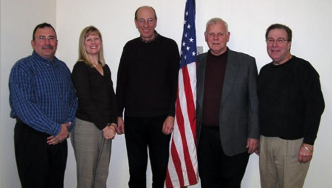 Longtime Ira Township Trustee Tom Jeannette, far right, passed away Tuesday. The board has 45 days to replace him.