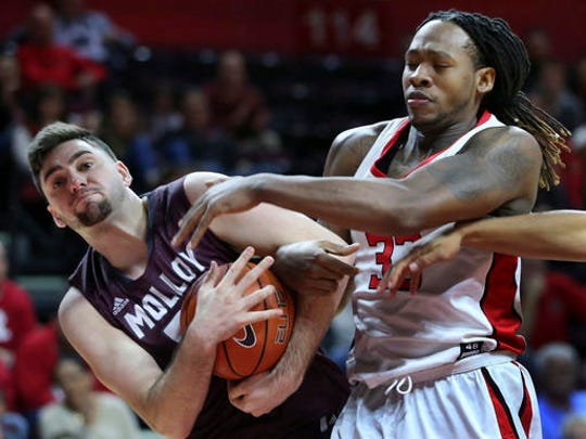 Rutgers' Deshawn Freeman, right, tries to make a steal as Molloy forward Mike Guzzardi tries to hold on to the ball during the first half.