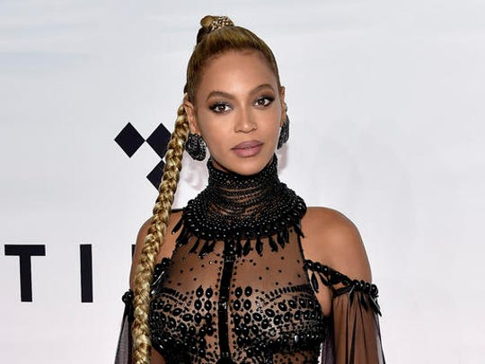 FILE - In this Oct. 15, 2016 file photo, singer Beyonce Knowles attends the Tidal X: 1015 benefit concert in New York.  Beyonce is nominated for Grammy Awards for best album, best song and record of the year.