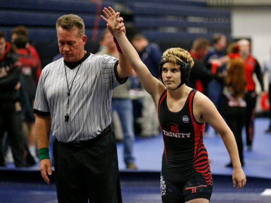 In this Feb. 18, 2017 photo, Euless Trinity's Mack Beggs is announced as the winner of a semifinal match after Beggs pinned Grand Prairie's Kailyn Clay during the finals of the UIL Region 2-6A wrestling tournament at Allen High School in Allen, Texas.   Beggs, who is transgender, is transitioning from female to male, won the girls regional championship after a female opponent forfeited the match.