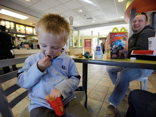 Henry Tonts, 3, of Hayward, Calif., eats french fries