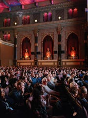 Moviegoers pack the Oriental Theatre for a screening