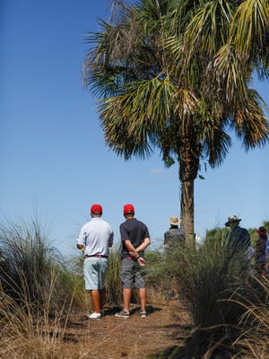 Two spectators enjoy a beautiful day as they watch the Chubb Classic at the Twin Eagles golf course in Naples, Fla. on Saturday, February 17, 2018.