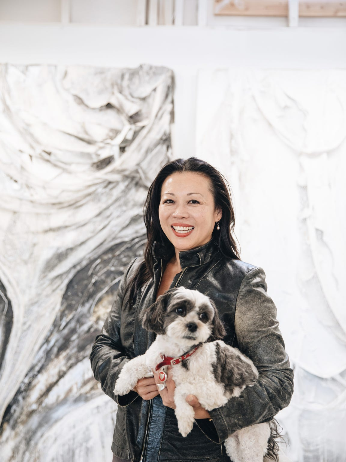 Artist Angel Chen with her dog, Romeo, at her studio