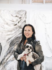 Artist Angel Chen with her dog, Romeo, at her studio in Joshua Tree