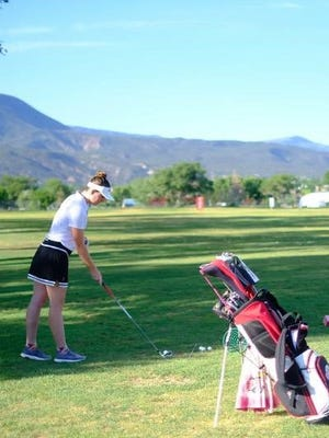 SUU golfer Katie Wills tees up for a drive during the 2018 Utah Summer Games golf tournament.