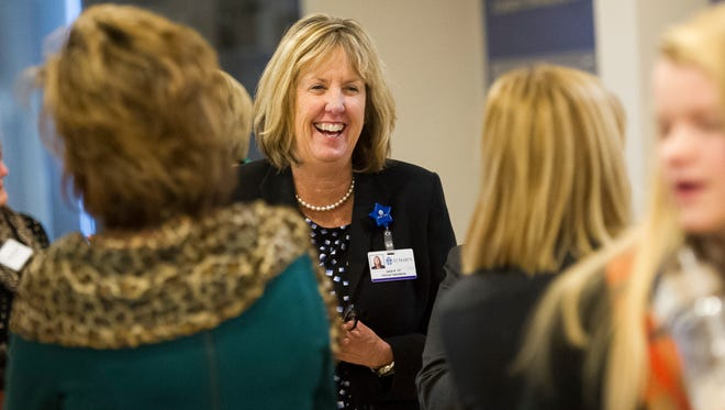 Janet Raisor, of Evansville, Executive Director Foundation Operations, Community Relations at St Mary's, center, speaks with other attendees during a news conference to announce the finalists for the 2017 ATHENA Award at The Southwest Indiana Chamber, Monday, Dec. 5, 2016. The winner will be announced during the annual ATHENA Award Luncheon in February.