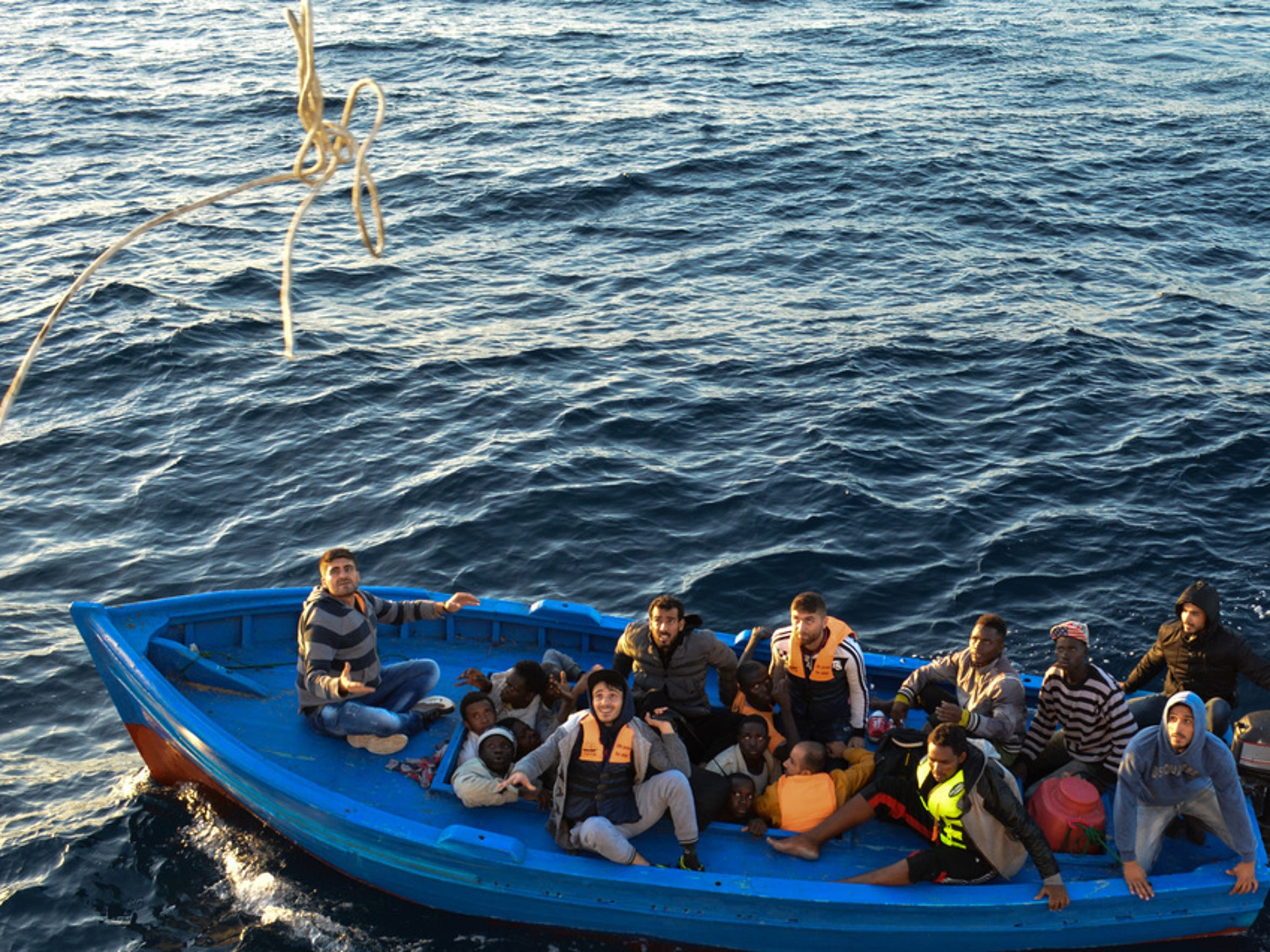 People crammed in a small wooden boat on the Mediterranean