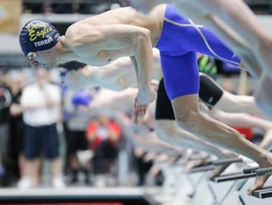 Andrew Torres competes in the 50 yard freestyle during