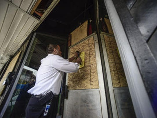 Binghamton Mayor Richard David hammers a lockdown notice