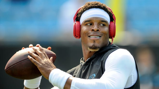 Carolina Panthers quarterback Cam Newton warms up prior to an NFL football game against the Buffalo Bills in Charlotte, N.C., Sunday, Sept. 17, 2017. (AP Photo/Mike McCarn) ORG XMIT: NCMM1