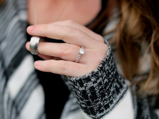 Jesse Worley, 24, shows her engagement ring and that of her fiancéŽ Jason Pittman, 25. Pittman died in the Warren County Jail September 17, 2015. They had recently become engaged and had two daughters. Worley now wears Pittman's ring around her neck.