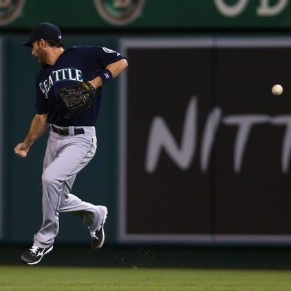 ANAHEIM, CA - SEPTEMBER 17:  A ball hit by David Freese (not pictured) of the Los Angeles Angels of Anaheim gets by right fielder Chris Denorfia #28 of the Seattle Mariners in the seventh inning at Angel Stadium of Anaheim on September 17, 2014 in Anaheim, California.  (Photo by Jeff Gross/Getty Images)