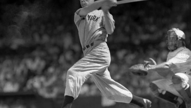 FILE -- Joe DiMaggio lines a single to left field in the seventh inning of the second game of a doubleheader at Washington, in this June 29, 1941 photo, to set a record for hitting safely in 42 consecutive games.  The catcher is Jake Early of the Washington Senators.  (AP Photo/File)