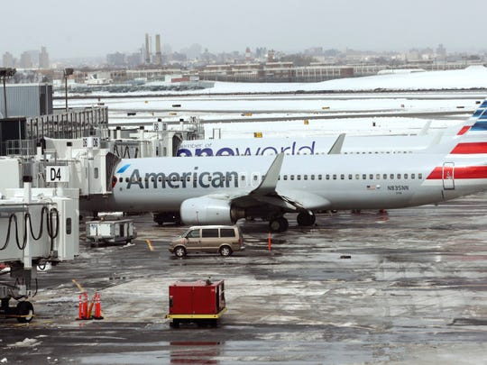 In this March 15 file photo, American Airlines airplanes sit on the tarmac at LaGuardia Airport in New York.