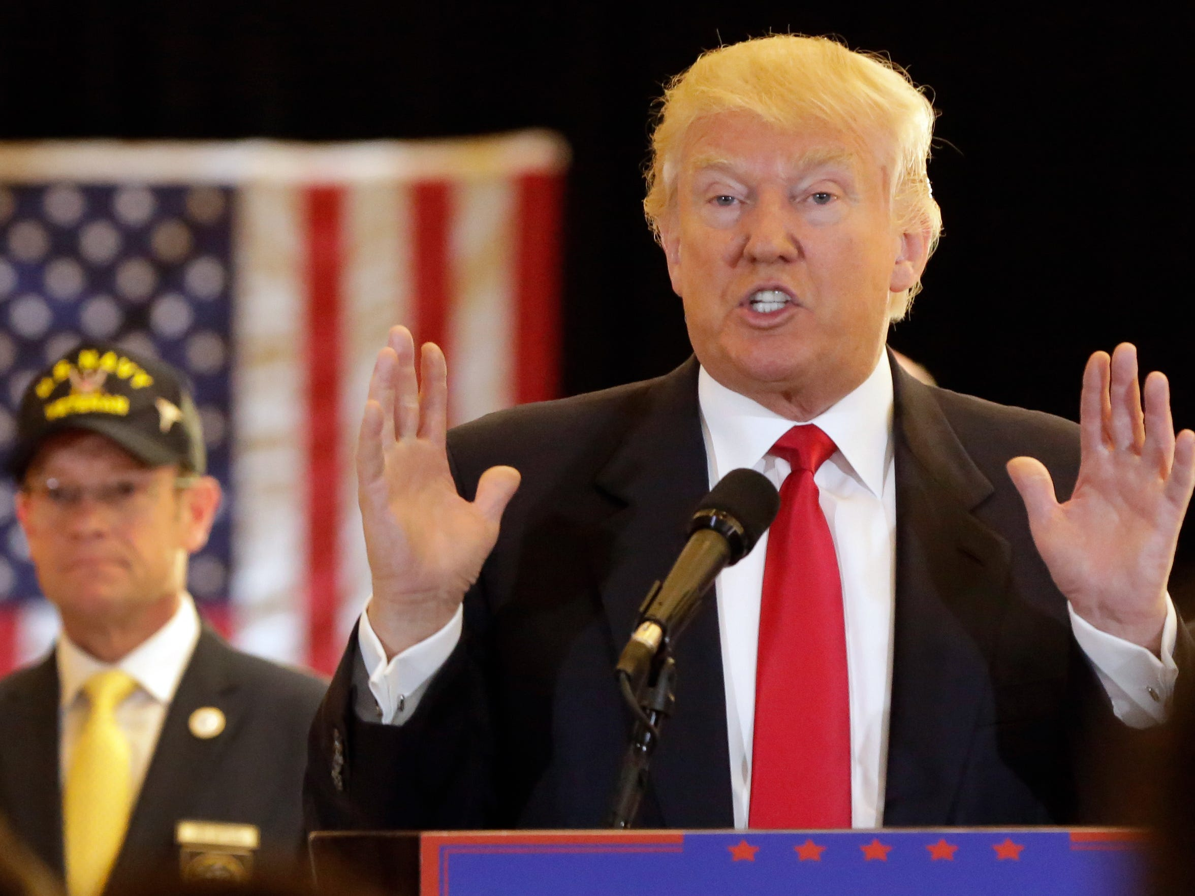 Republican presidential candidate Donald Trump answers questions during a news conference in New York on Tuesday. Trump is poised to get a tax cut by shifting his trademarks to a new Delaware company.