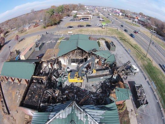 Demolition crews work Saturday afternoon on the Regions