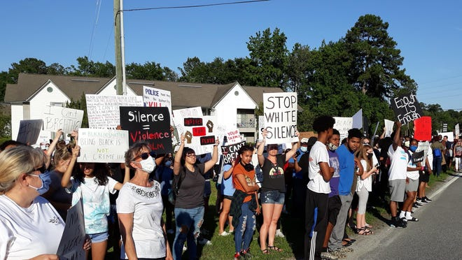 A racially diverse crowd participated in peaceful protest on June 1 in Richmond Hill.