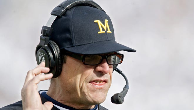 Michigan football coach Jim Harbaugh watches action against Penn State on Saturday, Nov. 21, 2015, at Beaver Stadium in University Park, Pa.