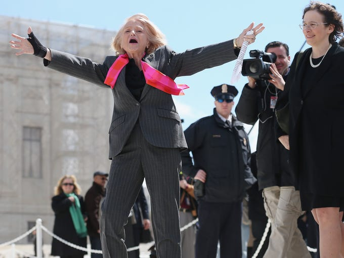 Edith Windsor acknowledges her supporters as she leaves