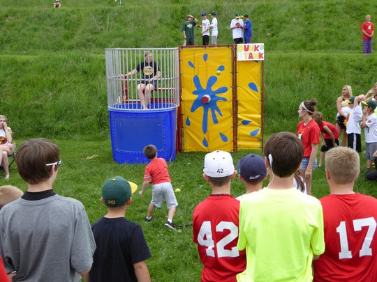West High physical education teacher Erika Mundt waits in the dunk tank Friday at the inaugural Flash Festival! organized by the West High School Dance Marathon.