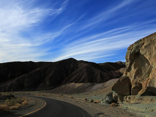 Shadows deepen along Artist Drive in Death Valley National Park as the sun sinks on the western horizon.
