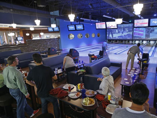A group gathers for a bowling game at FlipSide in Gilbert.