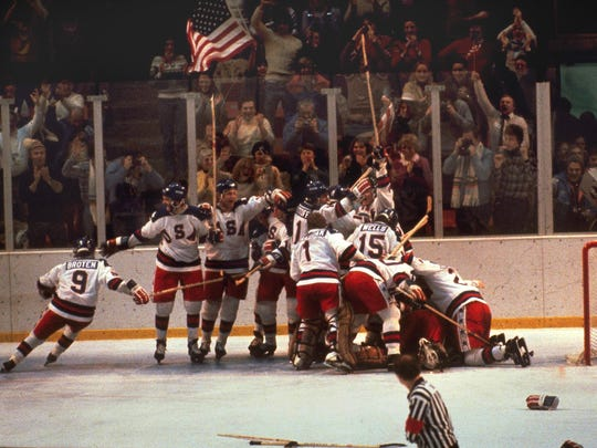 The U.S. hockey team pounces on goalie Jim Craig after a 4-3 victory against the Soviets in the Olympics, Feb. 22, 1980.
