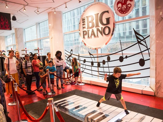 "Children play on the ""Big Piano,"" made famous by the"