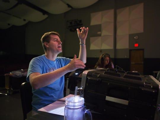 Karl-Erik Jansson, co-producer and vocal director, directs actors for Shrek the Musical Jr..