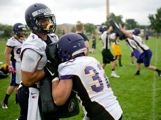John Kontowicz, left, and Brad Birkhauser, right, go through linebacker drills at the University of Wisconsin-Stevens Point football practice on Aug. 17.