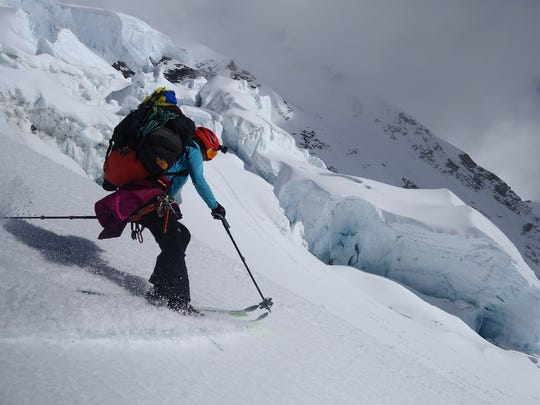 Mountaineer Emily Harrington of Squaw Valley, Calif., skis with a heavy pack on Makalu, the world's fifth-highest mountain, during a recent expedition.