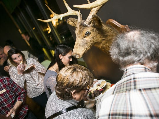 Guests sample offerings at the Wild About Vermont game