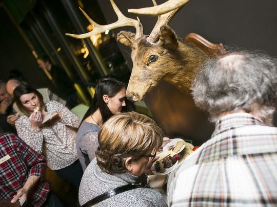 Guests sample offerings at the Wild About Vermont game dinner at Hotel Vermont in Burlington, on Saturday, November 7, 2015.