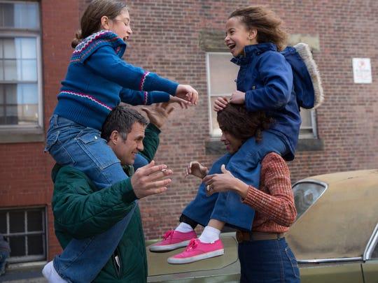 "From left, Imogene Wolodarsky as Amelia Stuart, Mark Ruffalo as Cam Stuart, Zoe Saldana as Maggie Stuart and Ashley Aufderheide as Faith Stuart in a scene from the film, ""Infinitely Polar Bear."""
