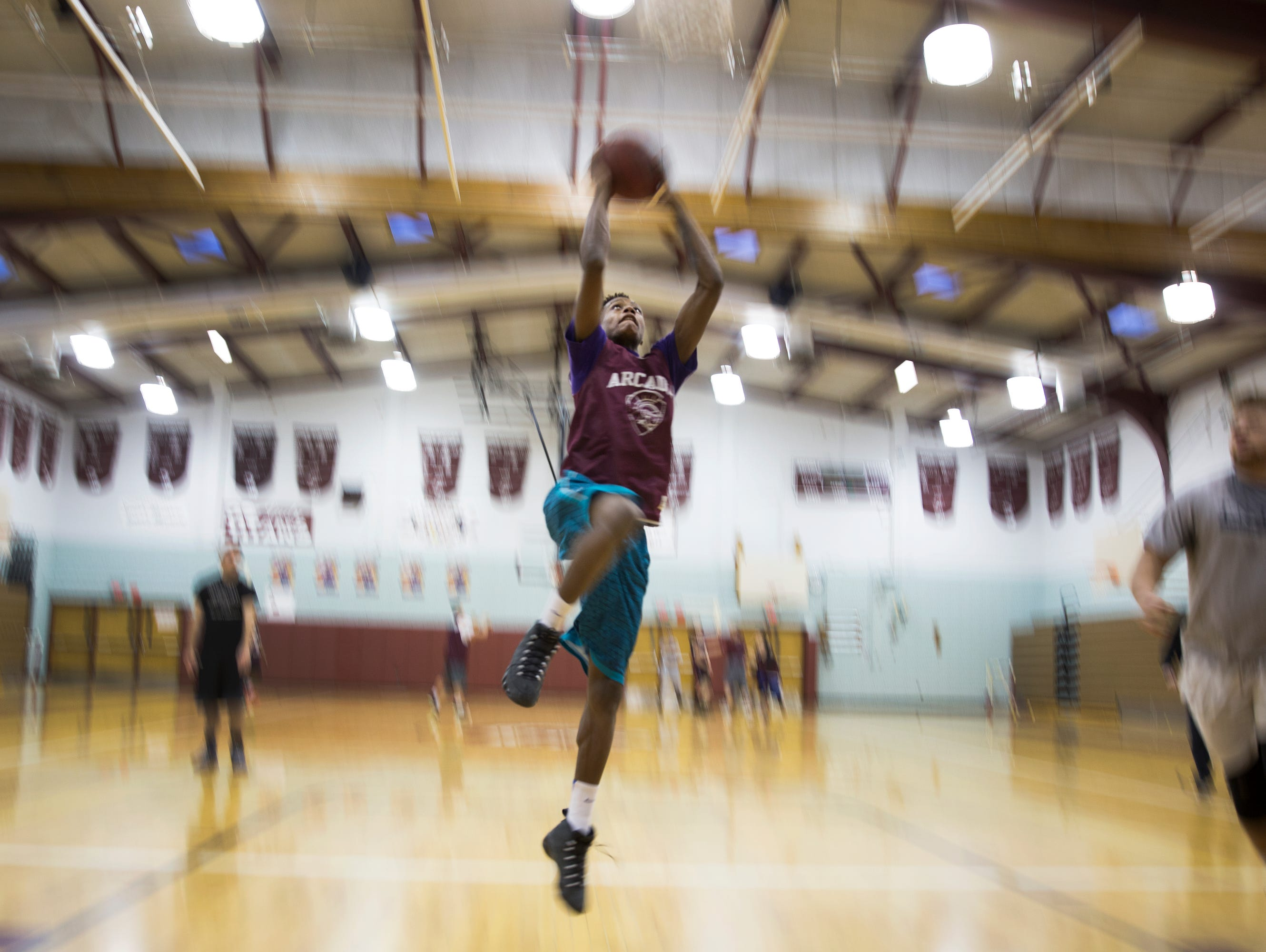 Keith McGee goes for a dunk during practice at Greece Arcadia High School on Wednesday, January 6, 2016.