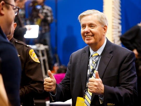 "Senator Lindsey Graham talks with media in the spin room, after the Republican Presidential Debate at Saint Anselm College in Manchester, N.H. on Saturday, Feb. 6, 2016. Graham, of South Carolina, last month canceled his own GOP presidential bid and endorsed Bush. ""A positive message is important, but you've got to show experience and resolve,"" he told reporters after the debate. ""Jeb Bush is the most prepared to be commander in chief on Day One, not John Kasich."""