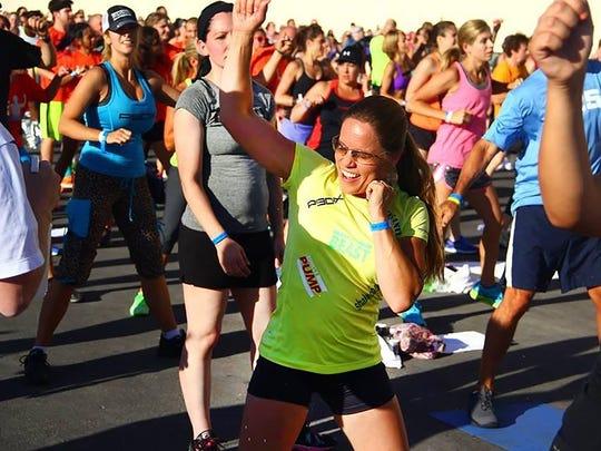Portland fitness coach Kina Wald trains during a Beachbody summit in Las Vegas in 2014.