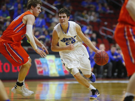 Gladbrook-Reinbeck's  Joe Smoldt drives the ball while being guarded by Jesup's Kyle DeBerg during Monday's Class 1A Iowa boys' state basketball tournament.