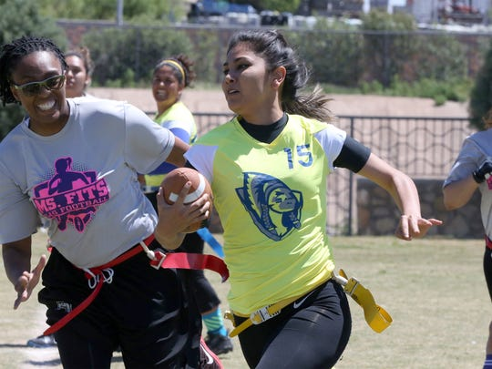 Munira Villa of the Universidad Autónoma de Ciudad Juárez Indias, takes off with the ball as El Paso Ms. Fits players try to catch her during an all-women's flag football tournament April 9 at Saipan Ledo Park in South Central El Paso. The Indias won the game 28-0, and later the championship game 14-12 against Girl Power. Players are hoping an all-women's league will be formed in El Paso.
