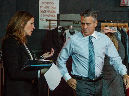 "Julia Roberts plays Patty Fenn and George Clooney plays Lee Gates in TriStar Pictures' ""Money Monster,"" opening May 13."