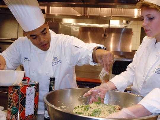 Chef Shawn Loving (left), here working with culinary student Leah Waldo, is in Rio for the 2016 Olympics.