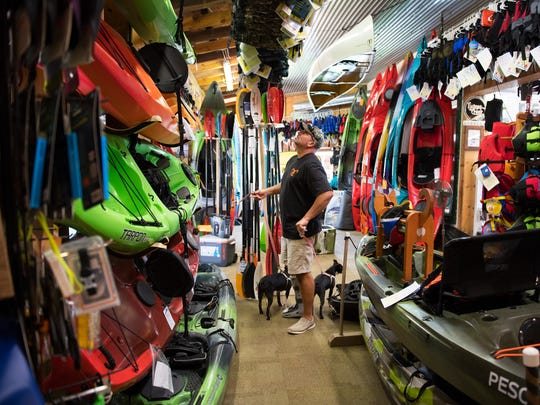 Mike Garcia of Simpsonville looks at kayaks in Sunrift Adventures in Travelers Rest on Friday, August 19, 2016.