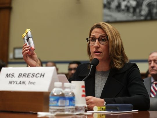 Mylan Inc. CEO Heather Bresch holds up a 2-pack of