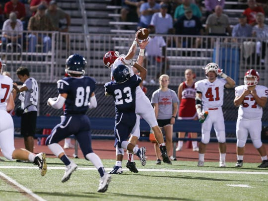 Cumberland Valley's Charlie Katshir (2) pulls down a pass in front of Justin Reichenbach, of Chambersburg, on Friday, Sept. 23. The Eagles won, 62-7.