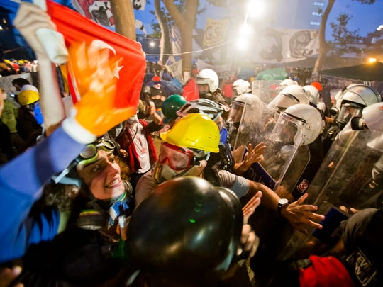 Protesters try to resist the advance of riot police in Gezi park in Istanbul, Turkey, June 15, 2013.