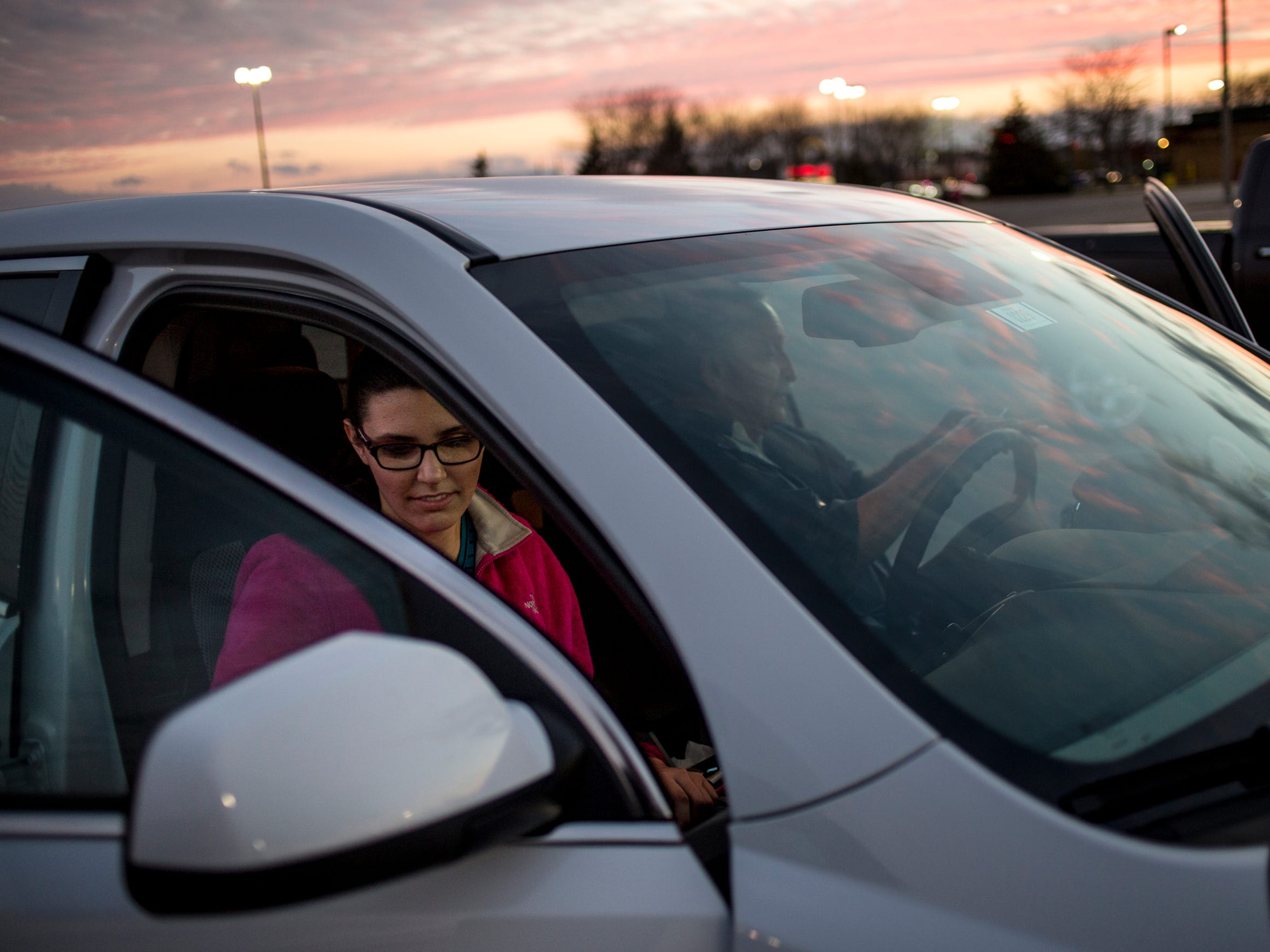 Alexandra Allers, 16, gets out of a vehicle with her
