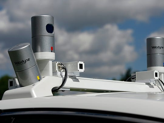 A Ford Fusion Hybrid autonomous test vehicle is shown equipped with LiDAR technology sensors on the roof of the vehicle at the Ford Product Development Center in Dearborn, Mich. Monday, Sept. 12, 2016. Gary Malerba/Special For DFP