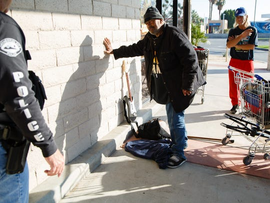 Cathedral City police officer Dwayne Hodge talks with George Raikoglo, a homeless resident from Cathedral City who Hodge has known for decades, Thursday, January 5, 2017.
