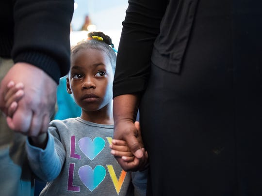 Malani Waler, 4, holds her grandparents' hands during service at Old Pilgrim Missionary Baptist Church in Simpsonville on Sunday, January 29, 2017.